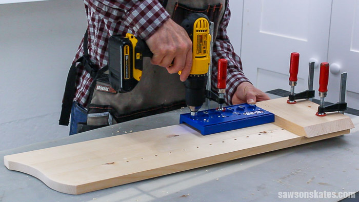 Drilling shelf pin holes in the side of a DIY display cabinet