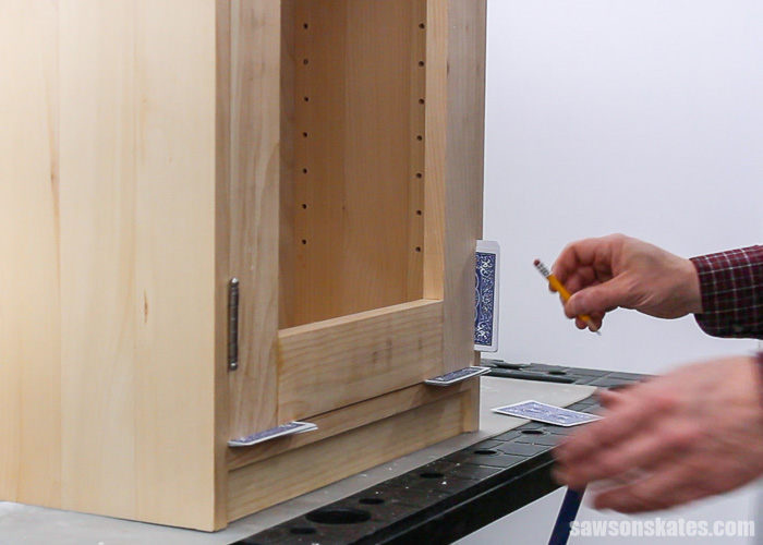 Marking the location for hinges on a the door of a DIY display cabinet