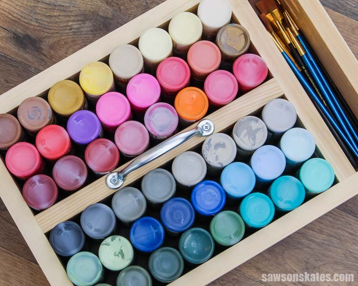 Looking overhead at a DIY acrylic paint storage organizer
