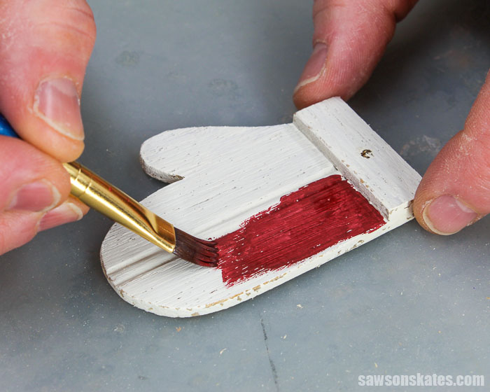 Painting a homemade wood mitten Christmas ornament