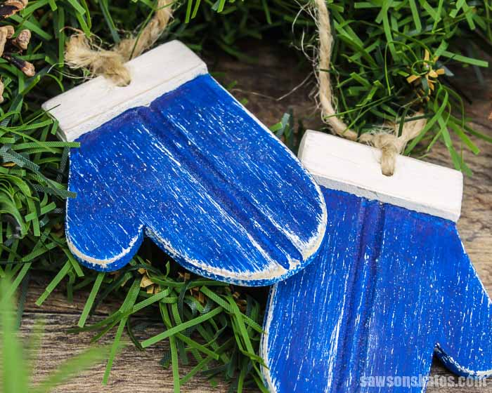 Two blue DIY wood mitten Christmas ornaments
