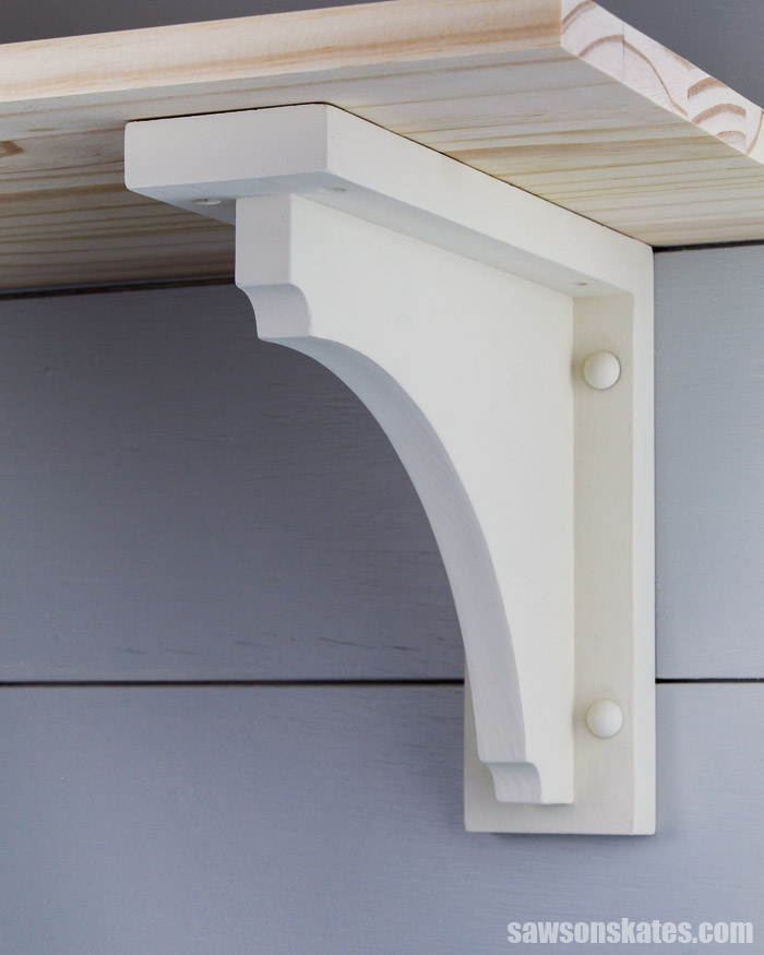 Save money and make your own DIY shelf brackets! These wall-mounted brackets are easy and inexpensive to make with scrap wood and a few common tools.