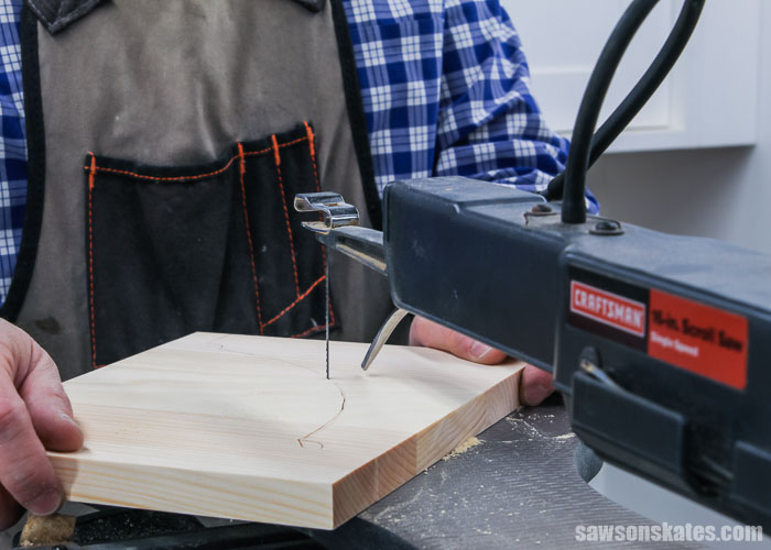 Using a scroll saw to cut out inexpensive DIY shelf brackets