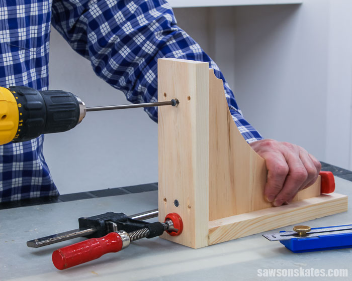 Using a drill to drive a wood screw to assemble DIY shelf brackets
