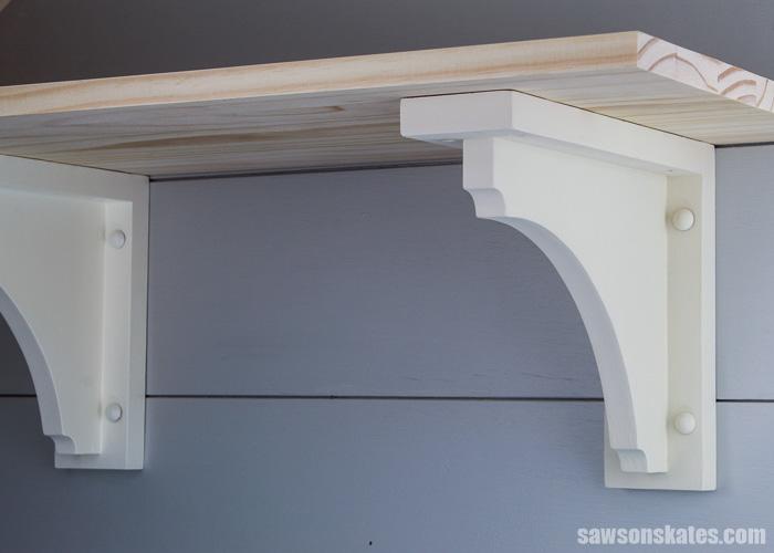 A simple wood shelf made with two DIY shelf brackets