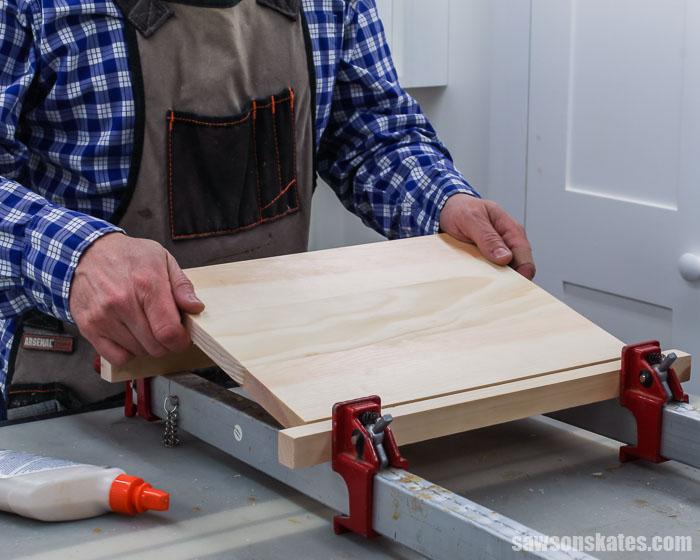 Gluing up scrap wood to make DIY shelf brackets