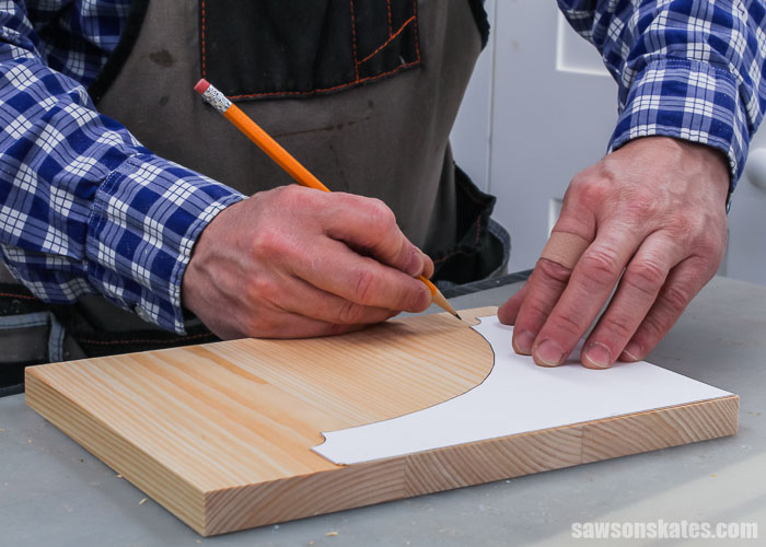 Tracing a template onto a wood blank for large DIY shelf brackets