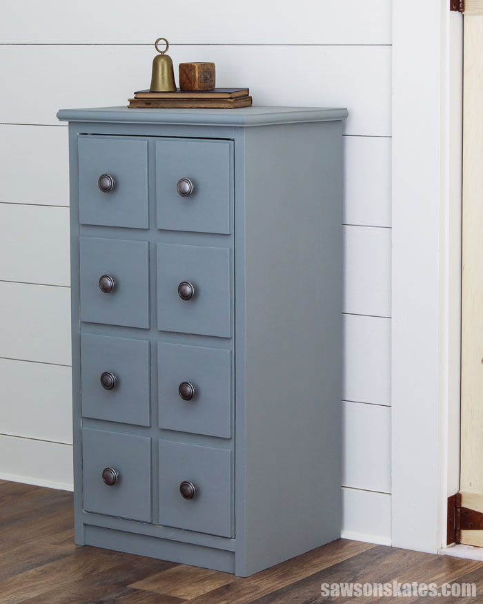 This DIY apothecary cabinet is a stylish way to add storage to any room. The faux drawers hide books, remotes, and more. It's easy to make with these plans.