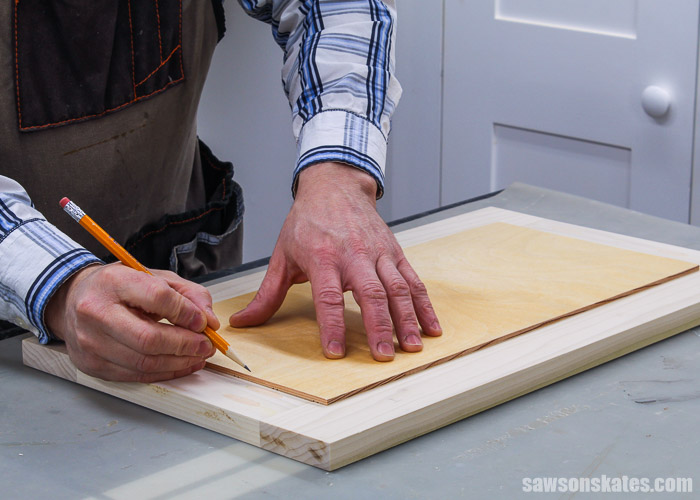 Tracing the panel on the back of a DIY cabinet door frame