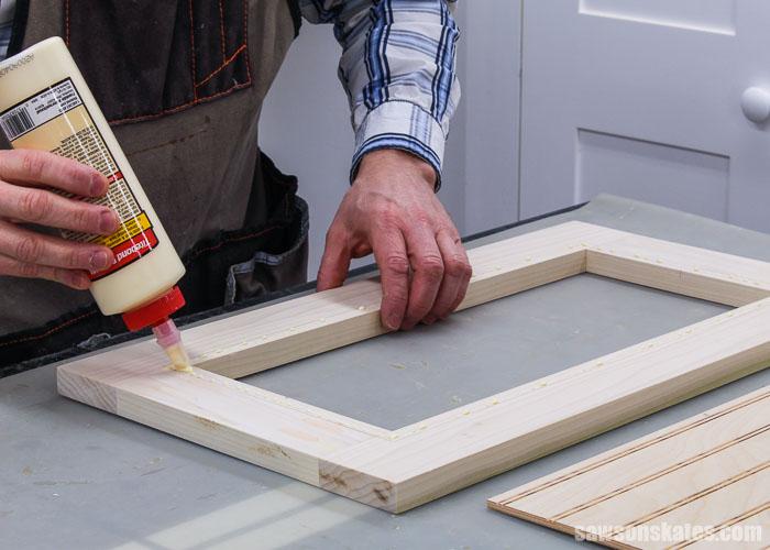 Applying glue to a DIY cabinet door