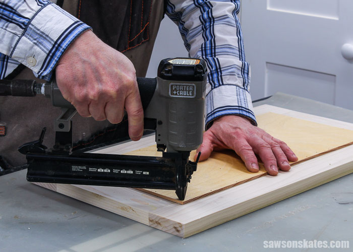 Attaching a panel to a DIY cabinet door with a brad nailer