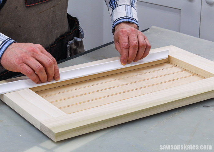Positioning the molding on a DIY cabinet door