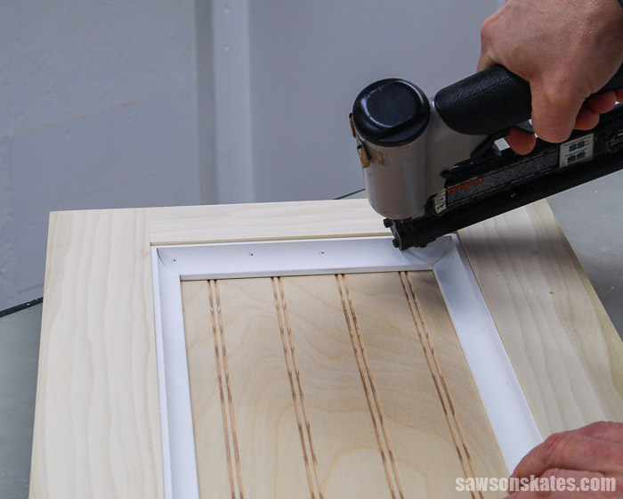 Attaching the molding to a DIY cabinet door with a brad nailer