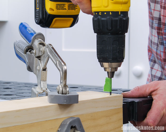Drilling a pilot hole drill before drilling a countersink hole with a fluted countersink bit