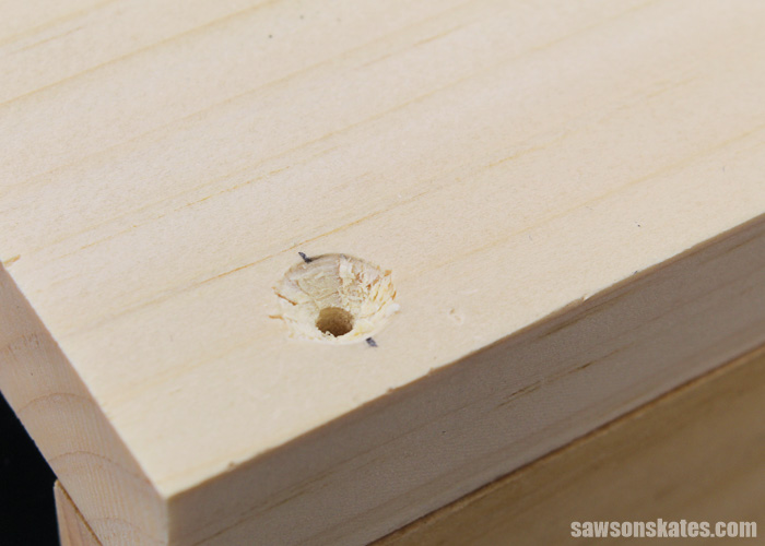 Countersink hole drilled into a piece of wood