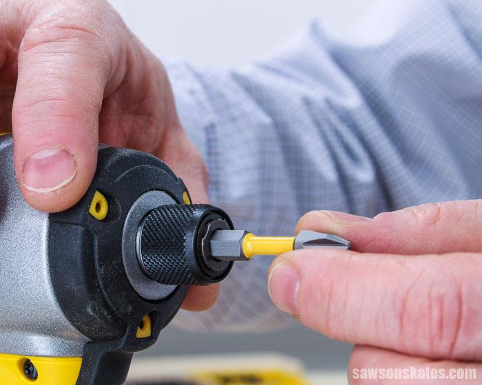Putting a screwdriver bit in an impact driver