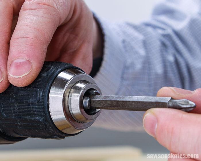 Putting a screwdriver bit in a drill