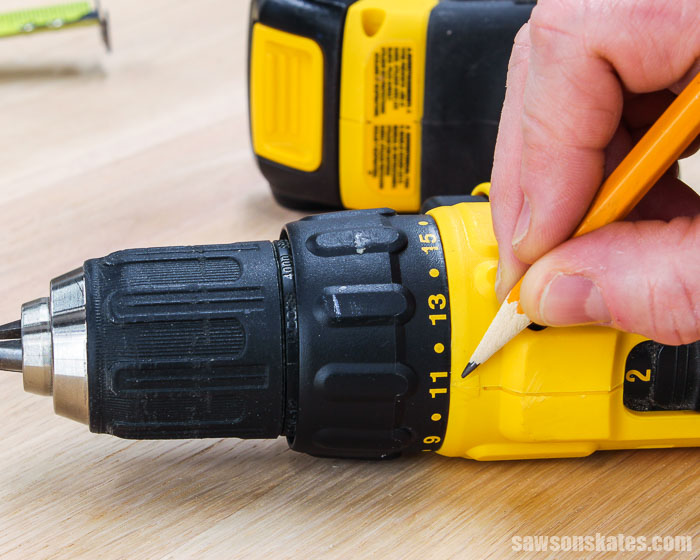 Pencil pointing to the torque setting on a drill