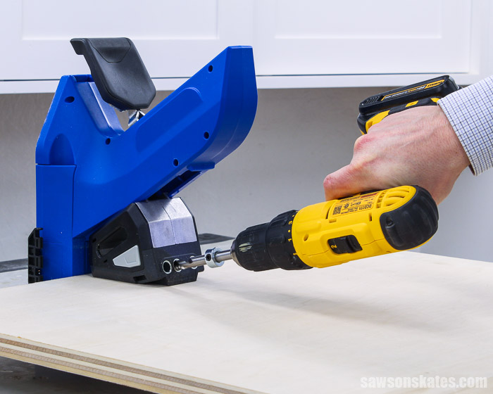 Using the Kreg Jig 720 to drill pocket holes in a piece of plywood