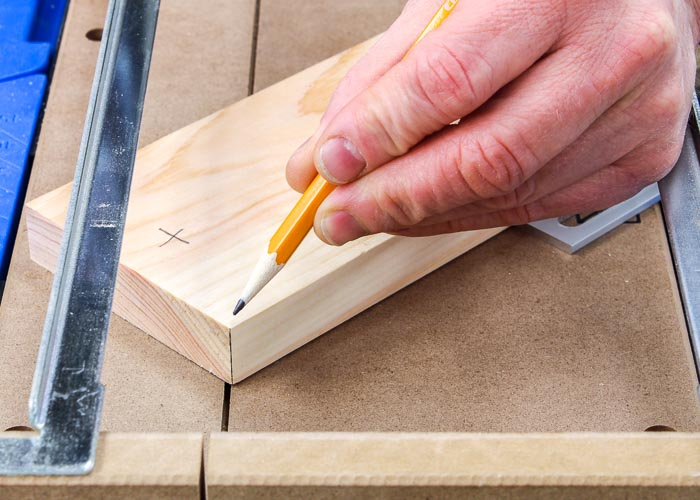 Positioning a board for a miter cut in a Kreg Crosscut Station