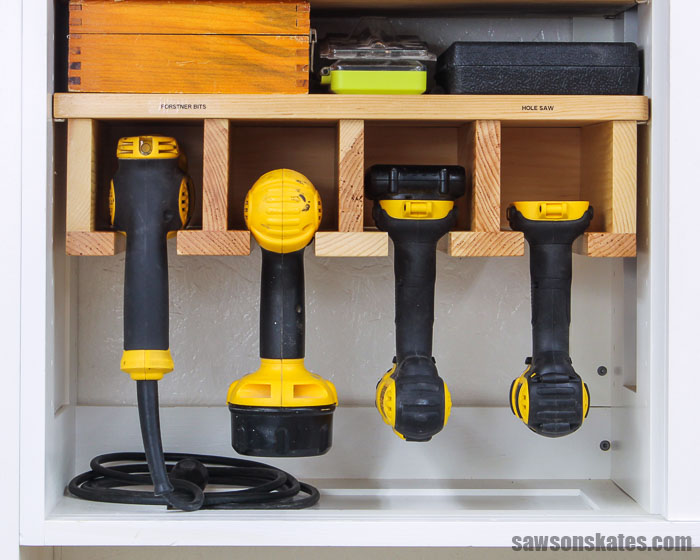 Front view of a DIY drill holder with four drills