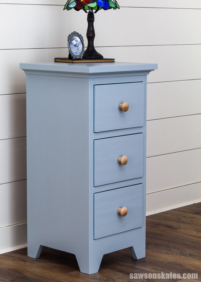Need some storage in your bedroom? Make this adorable DIY nightstand with three drawers. Learn how to build it with a few common tools and these free plans.