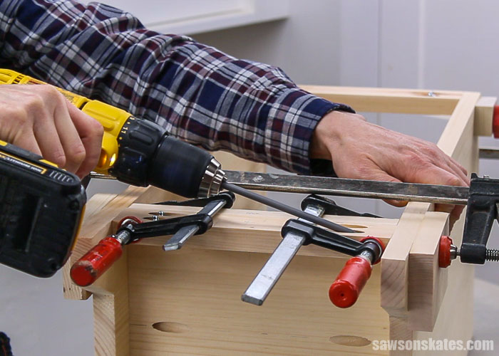 Attaching the back rail of a DIY nighstand with drawers