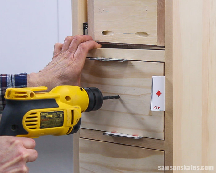 Drilling a hole in a drawer front for a DIY nightstand