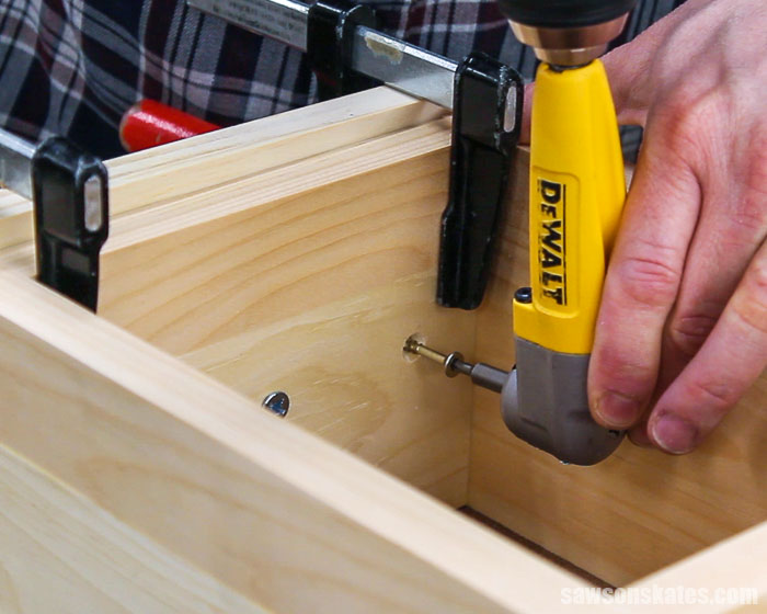 Drill driving a screw to attach a drawer box to a drawer front for a DIY nightstand
