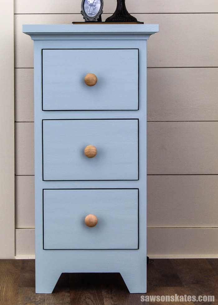 Front view of a DIY nightstand with three drawers