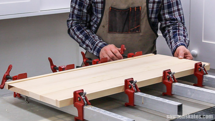 Glueing up a side panel for a DIY nightstand with drawers