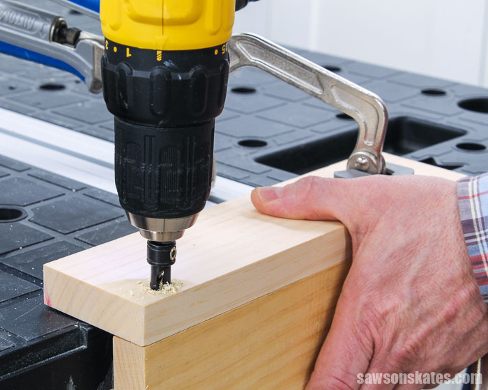 Drilling a hole after making a starting point with an awl.