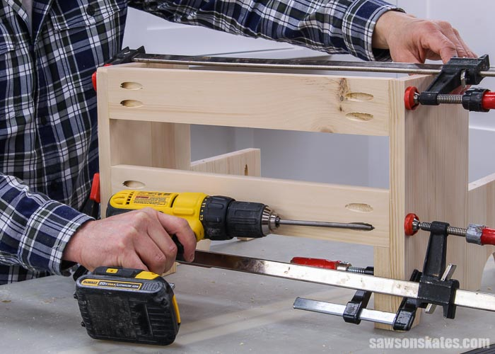 Attaching the back rails of an antique-inspired DIY step stool