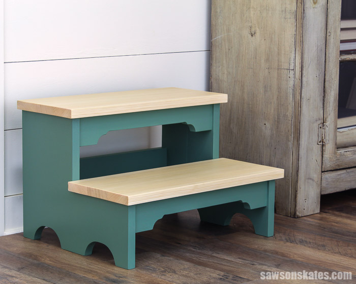 Two-step DIY step stool next to a bookcase