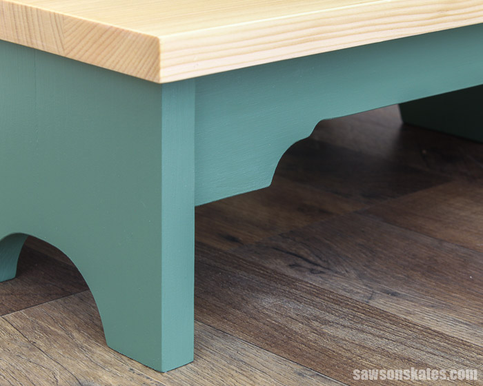Antique-inspired curved details on the step and rail of a DIY step stool