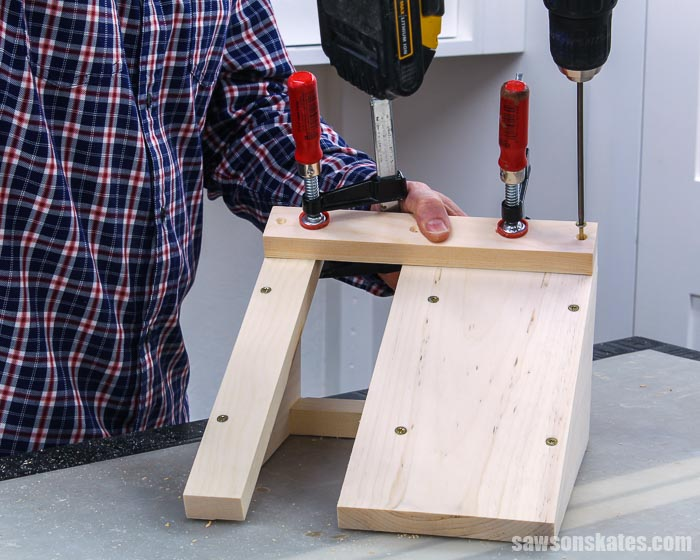 Attaching the cleat on the front of a DIY circular saw storage holder