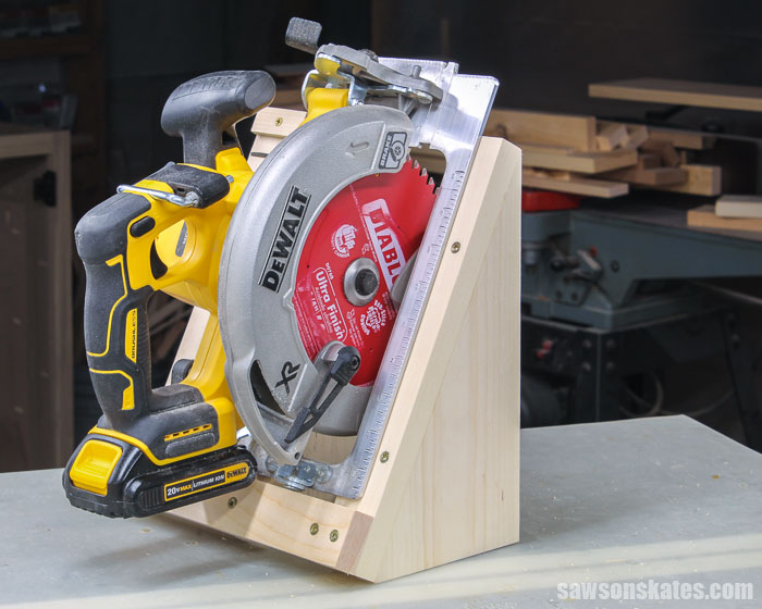 Get your workshop organized with this DIY circular saw storage holder. Make one for free with a few pieces of scrap wood and these step-by-step plans.