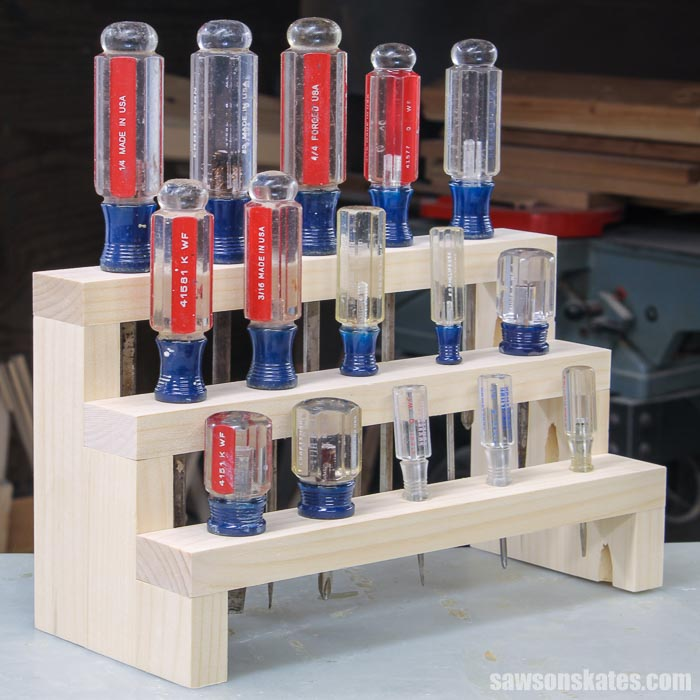 Angled view of a DIY screwdriver holder with three tiers and 15 screwdrivers