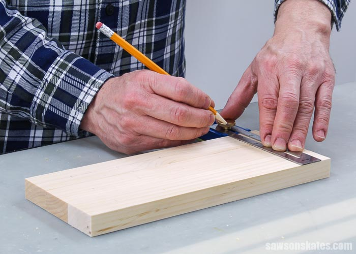 Marking hole locations for a DIY screwdriver holder