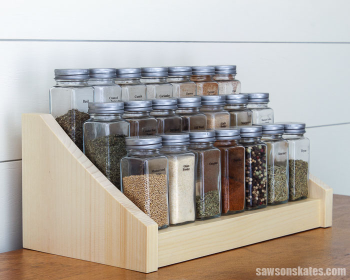 Get your spices organized with this DIY tiered spice rack. This 3 tier shelf keeps spices at your fingertips. It's easy to make with these free plans.