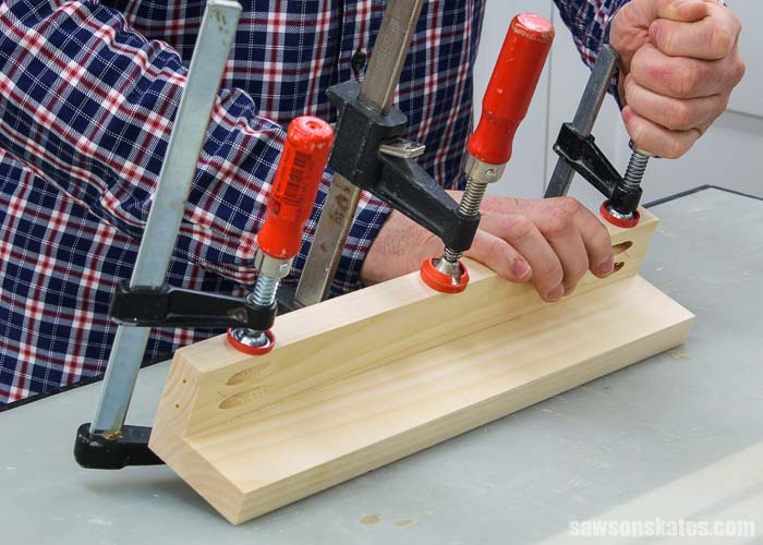 Clamping the middle shelf of a DIY tiered spice rack