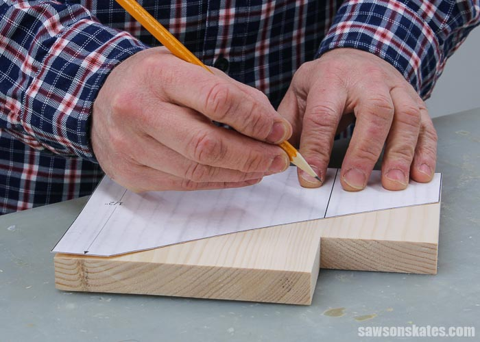 Tracing the template on the side of a  DIY 3 tier spice rack