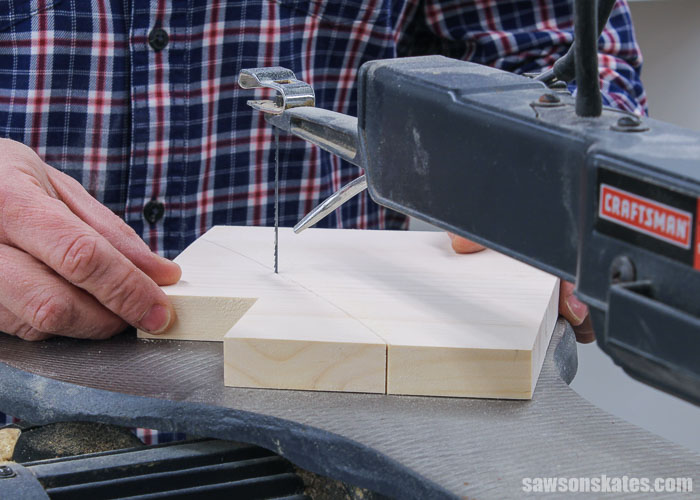 Using a scroll saw to cut out the side of a DIY wood tiered spice shelf
