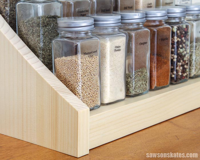 Corner detail of a DIY tiered spice rack