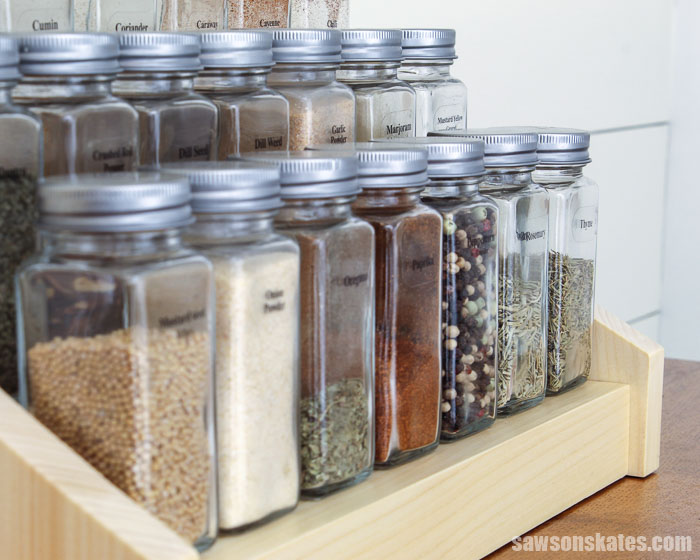 View across the front of a DIY tiered spice rack