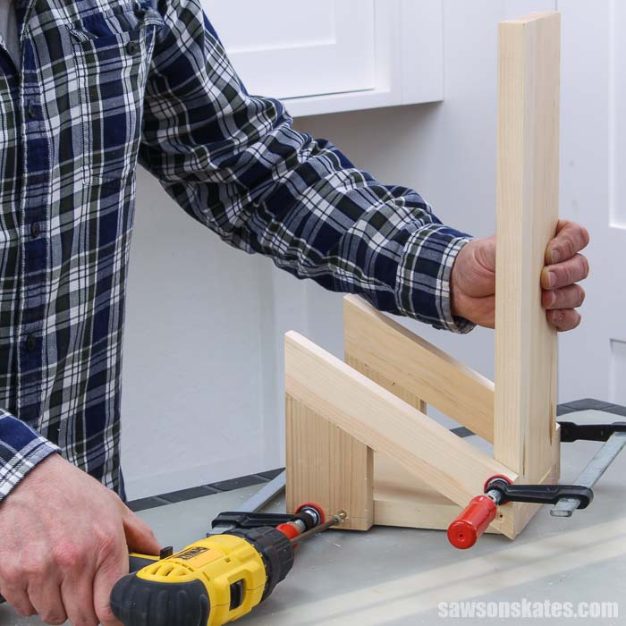 Attaching the bottom holders on a DIY saw blade storage rack