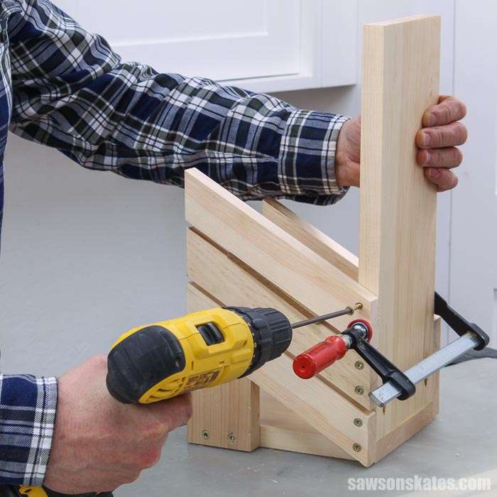 Attaching the upper holders on a DIY saw blade storage rack