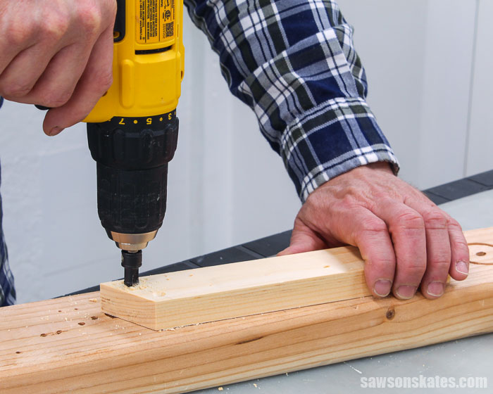 Using a countersink drill bit to make holes in holders for a DIY saw blade storage rack