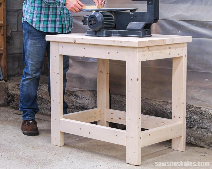 Get your benchtop tools organized with this DIY power tool stand. This sturdy stand is easy to make with only six 2×4s and these simple step-by-step plans.