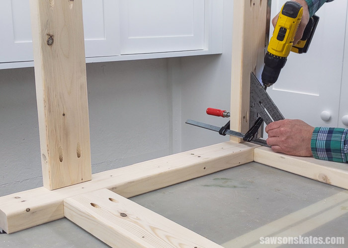 Driving screws to attach the top side rail of a DIY power tool stand